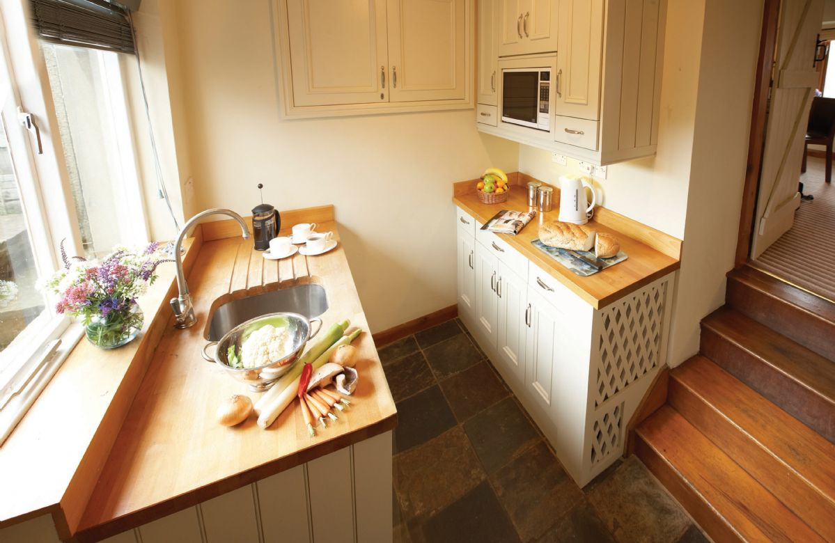 Barn Cottage is located in Carlton in Coverdale